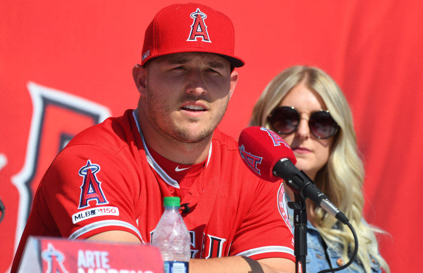Mike Trout and wife Jessica take part in a news conference.