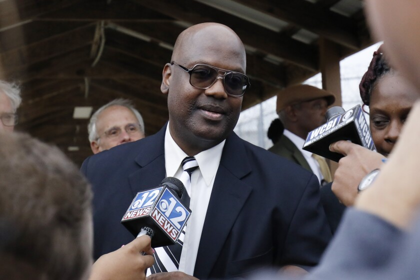 FILE - In this Monday, Dec. 16, 2019 file photo, Curtis Flowers speaks with reporters as he exits the Winston-Choctaw Regional Correctional Facility in Louisville, Miss. Mississippi's new attorney general must decide whether to take a quadruple murder case to a seventh trial. Curtis Flowers has had two mistrials and four reversed convictions in connection with the 1996 slayings of four people at a furniture store. (AP Photo/Rogelio V. Solis, File)