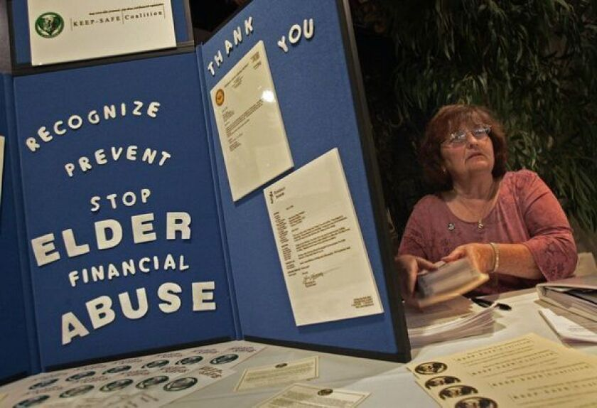 A display at a 2007 Torrance fundraiser aimed at stemming elder financial abuse.