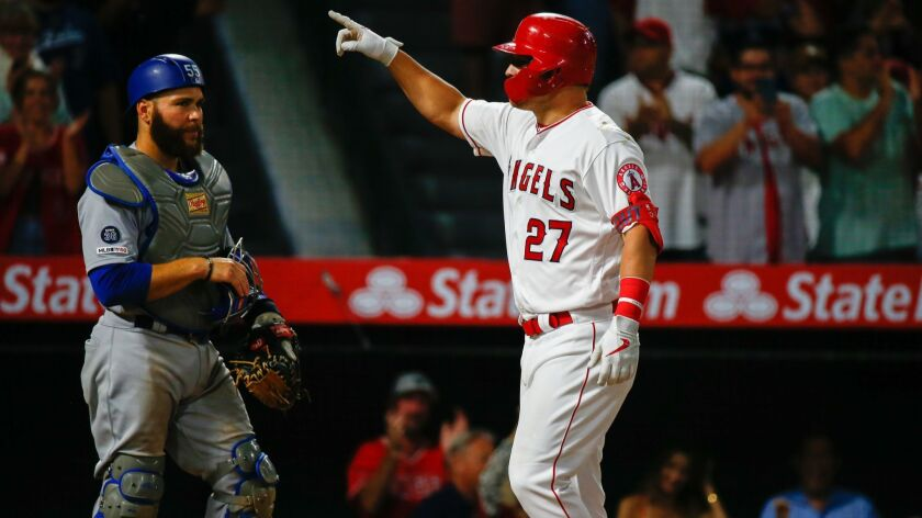 ANAHEIM, CALIF. - JUNE 10: Los Angeles Angels center fielder Mike Trout (27) gestures as he crosses