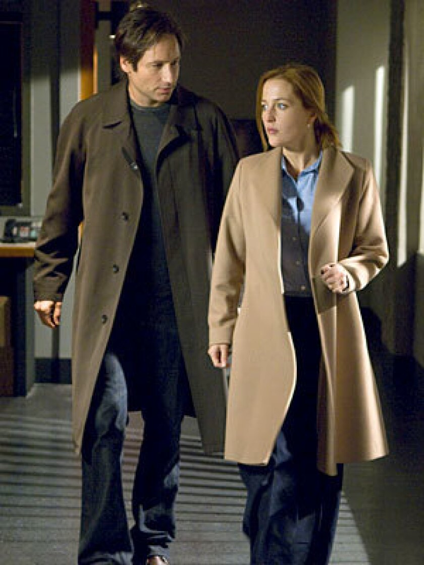 The audience got some vague reassurances from Chris Carter, including word that Scully (Gillian Anderson, right) and Mulder's (David Duchovny) child William would not go unnoticed in the film.