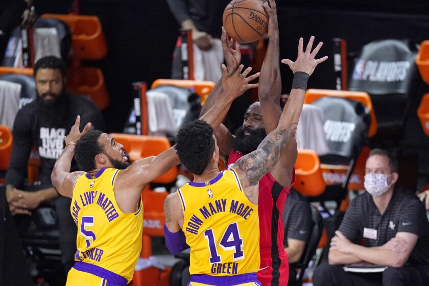 Lakers guards Talen Horton-Tucker (5) and Danny Green (14) trap Rockets star James Harden during Game 4 on Sept. 10, 2020.