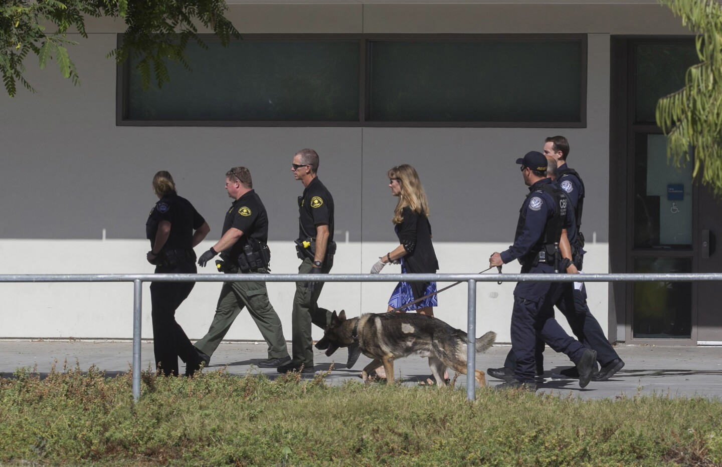 Sheriff's and CBP officers walked through the Grossmont High School campus where students were locked down at 8:45 a.m. Thursday after a student reported seeing what they thought was a gun in a students back pack.