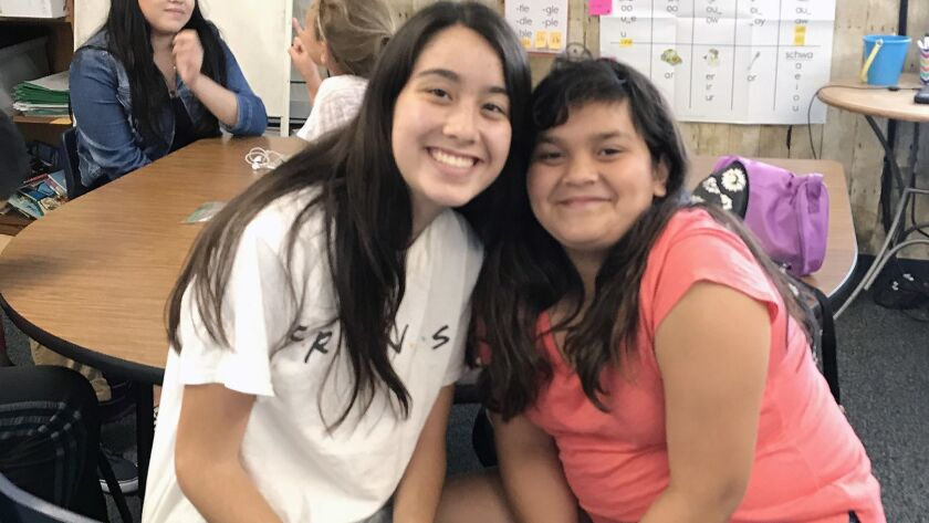 """Corona del Mar High School senior Sara Neiger with her """"little sister"""" Kalina, who attends Sonora Elementary School in Costa Mesa. The two are part of a Big Brothers Big Sisters of Orange County and the Inland Empire program that pairs high school and elementary school students."""
