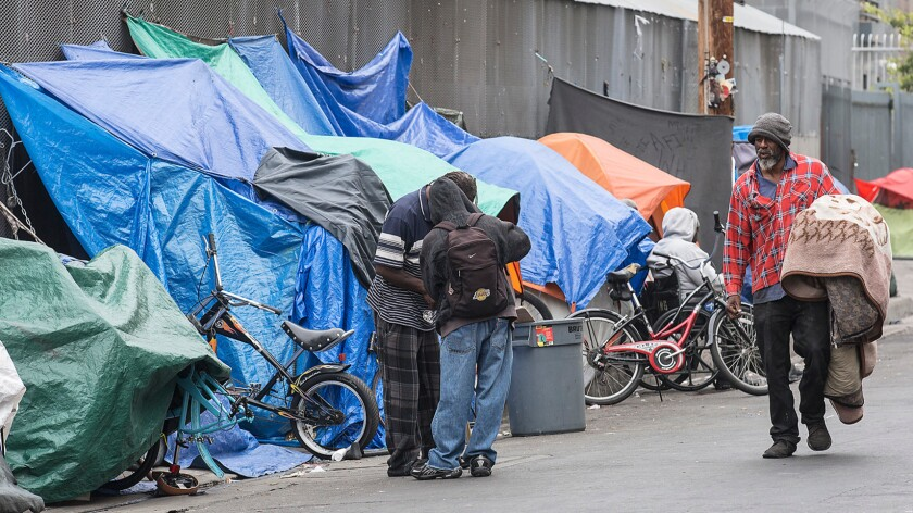 Homeless people at an encampment on L.A.'s skid row.