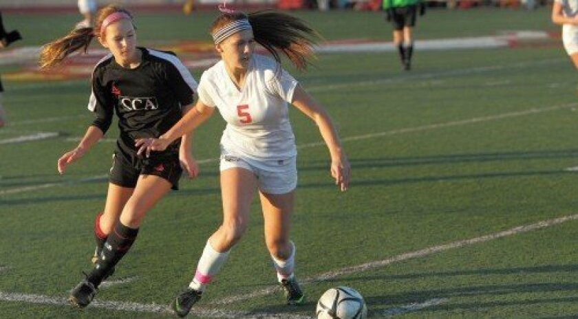 CCA player Rachel McDonald presses the outside to get past Cathedral Catholic's Brittany Doan.