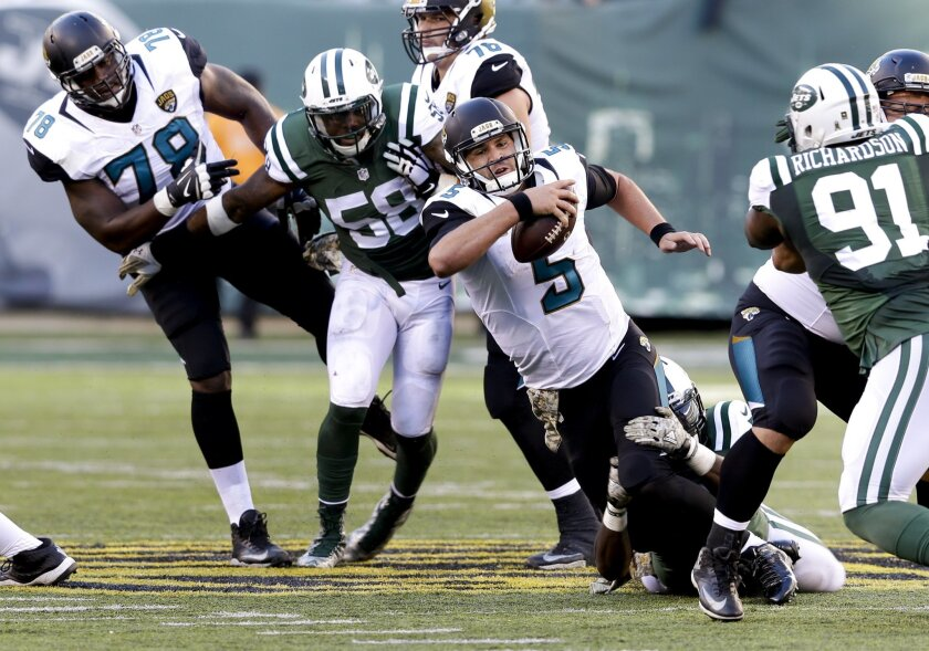 Jacksonville Jaguars quarterback Blake Bortles (5) is sacked by the New York Jets during the third quarter of an NFL football game, Sunday, Nov. 8, 2015, in East Rutherford, N.J. (AP Photo/Seth Wenig)