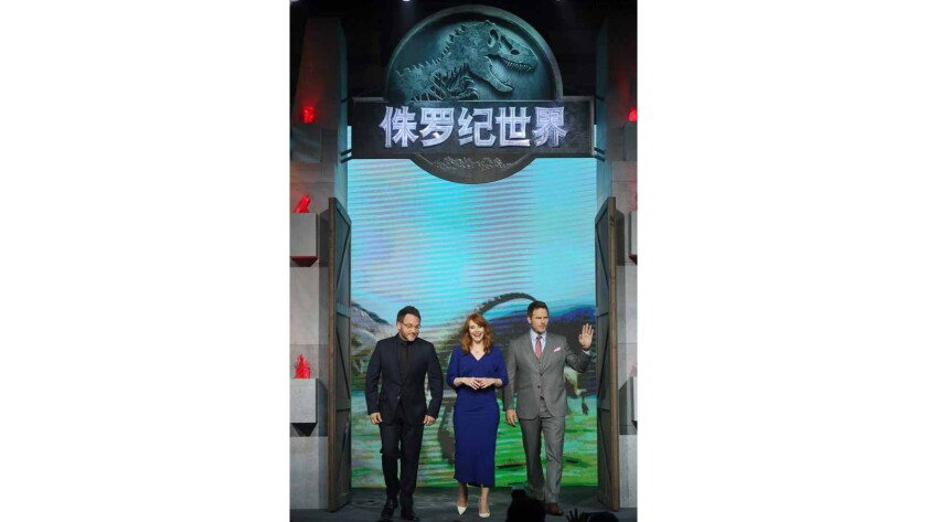 """From left, """"Jurassic World"""" director Colin Trevorrow, actress Bryce Dallas Howard and actor Chris Pratt attend a news conference at Yintai Centre on May 26, 2015, in Beijing."""