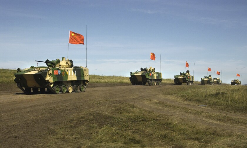 A convoy of Chinese APCs roll by during a 2007 rehearsal for a massive joint military exercise.