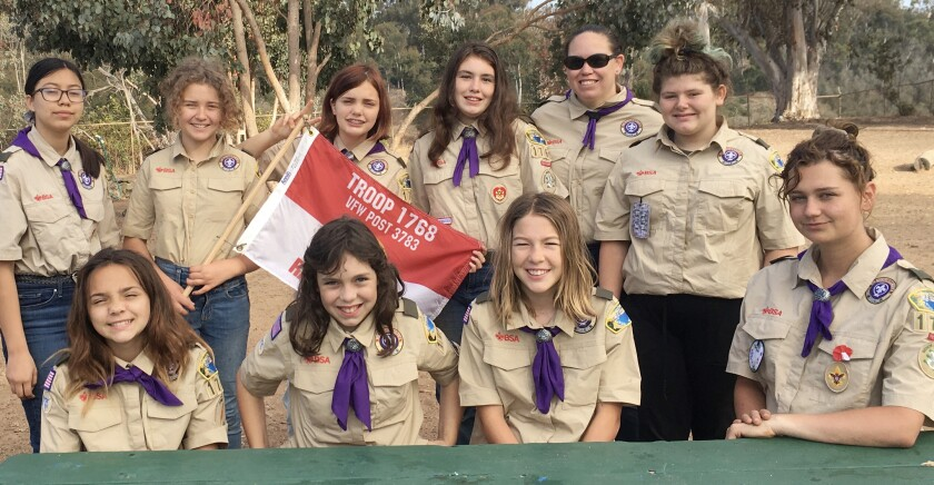 Female members of Scouts BSA Troop 1768 are planning scuba-diving, snow sports and movie-making activities.