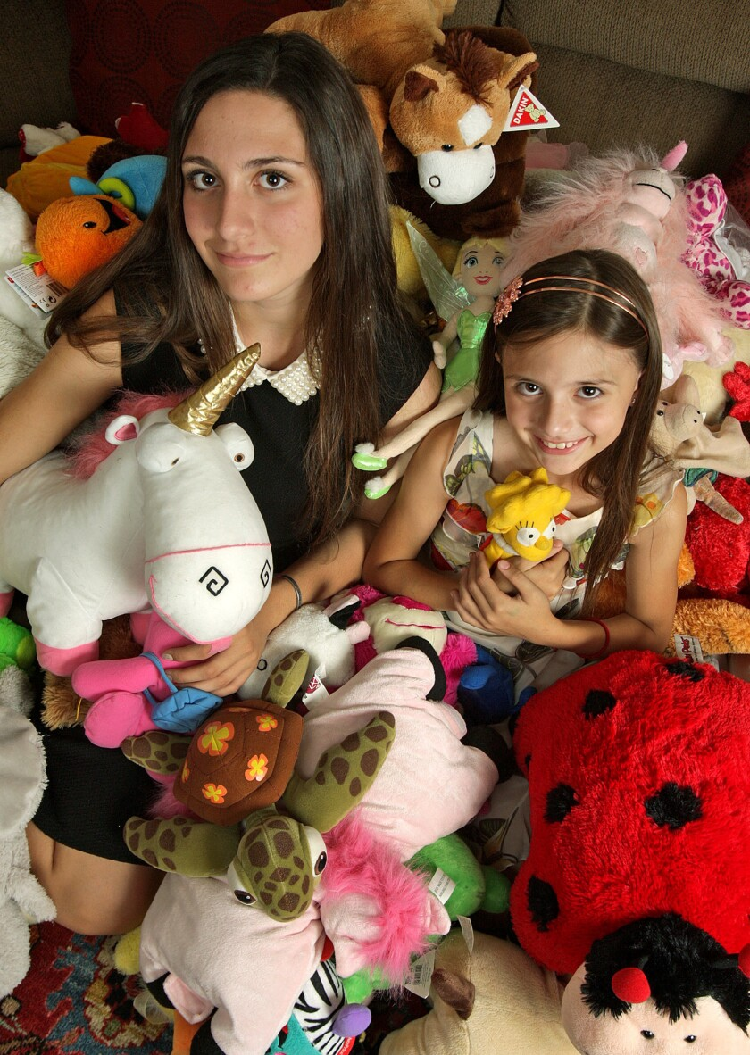 Glendale sisters Madison and Zaris Zavala with stuffed animals