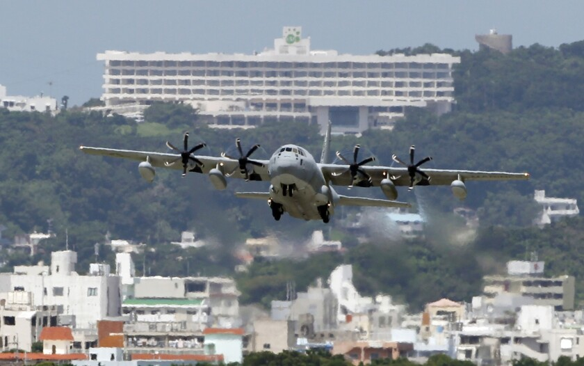 A plane takes off from the U.S. Marine Corps base in Okinawa