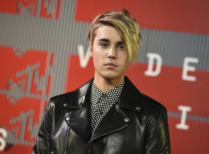 FILE - In this Aug. 30, 2015, file photo, Justin Bieber arrives at the MTV Video Music Awards in Los Angeles. Bieber received a favorable probation report in a misdemeanor vandalism case on Monday, Nov. 2, 2015, and a Los Angeles judge ruled that the pop singer will no longer be on supervised proba