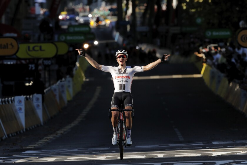 Denmark's Soren Kragh Andersen crosses the finish line to win the 14th stage of the Tour de France cycling race over 194 kilometers (120,5 miles) with start in Clermont-Ferrand and finish in Lyon, France, Saturday, Sept. 12, 2020. (AP Photo/Christophe Ena, Pool)