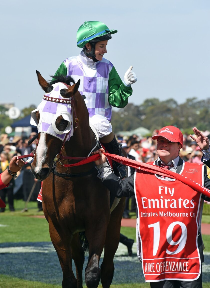 Prince Of Penzance jockey Michelle Payne celebrates with strapper Stevie Payne after winning the Melbourne Cup at the Flemington Racecourse in Melbourne, Australia, Tuesday, Nov. 3, 2015. (AP Photo/Andy Brownbill)