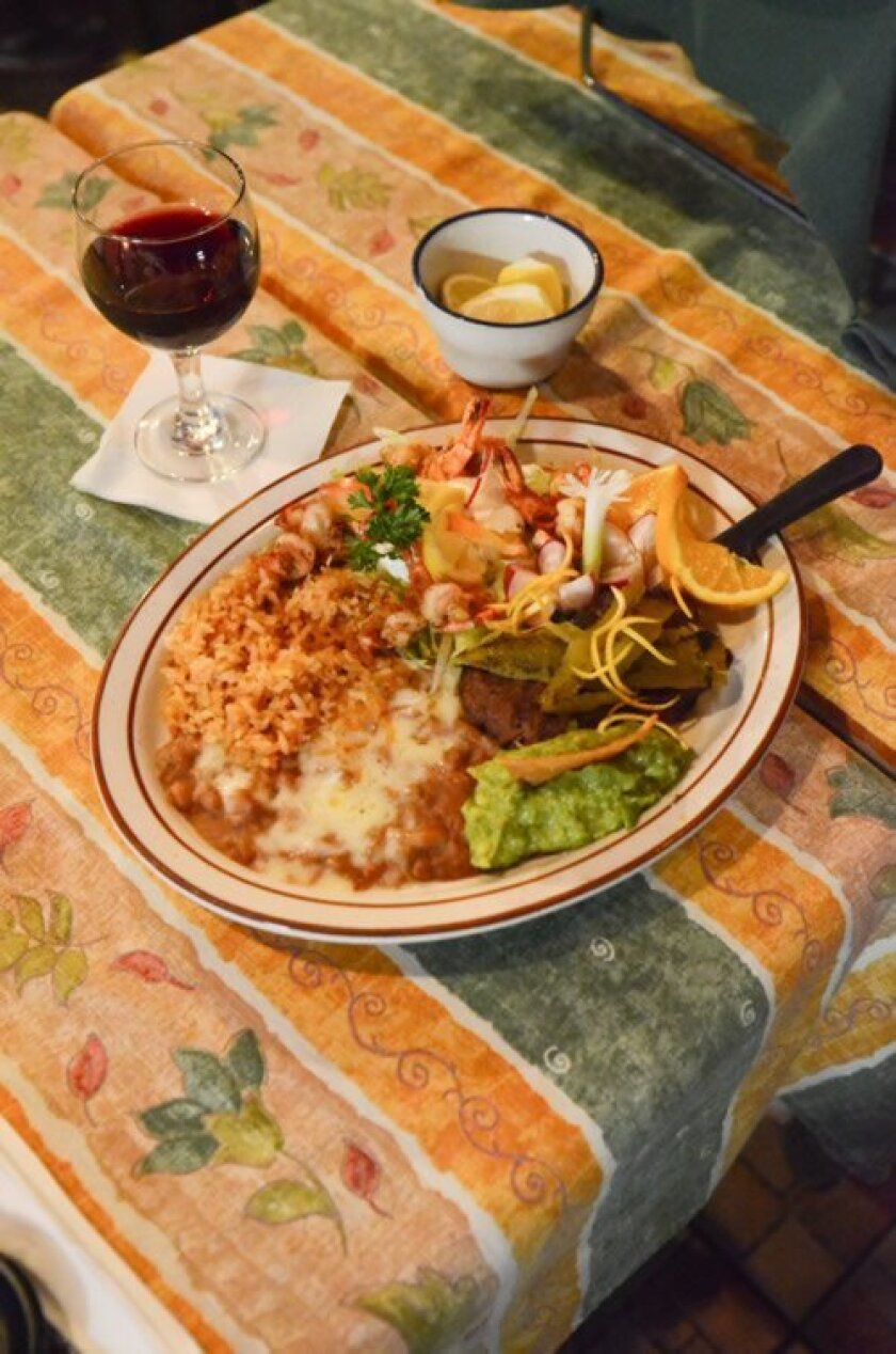 Alfonso's most popular dish is the Carne Asada and Camaron Combo served wtih rice and beans. Photo by Kelley Carlson