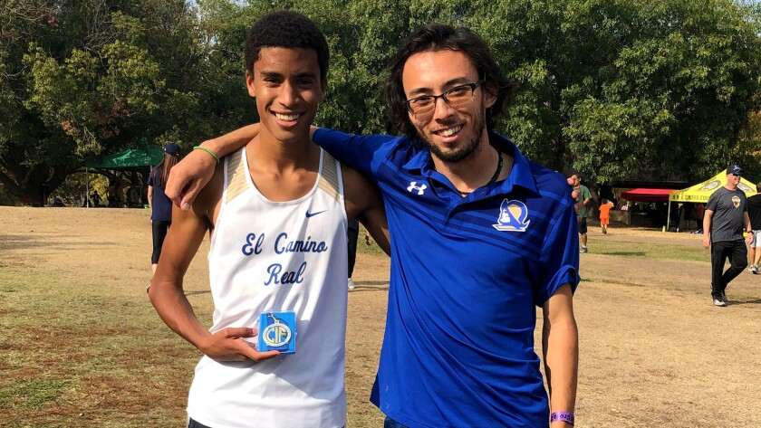 Coach Jun Reichl, right, in 2017 helped Justin Hazell of El Camino Real become the first City Section boys' runner to win the state Division I cross-country title.