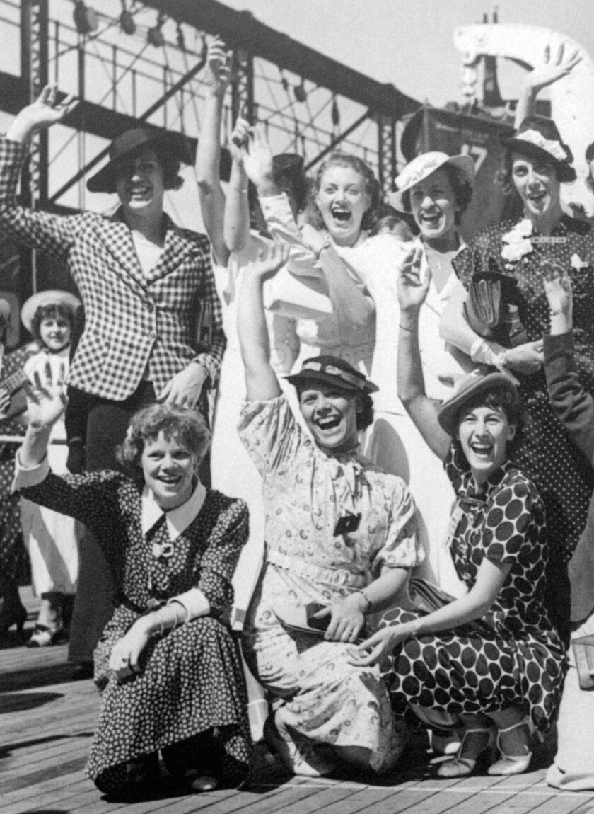 In this 1936 photo, Simone Schaller, lower right, waves with members of the United States women's Olympic track and field team as they depart for Europe on the SS Manhattan.