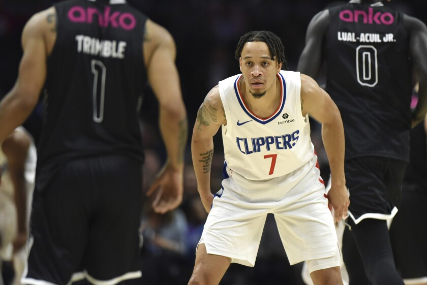 Clippers guard Amir Coffey takes part in an exhibition game.
