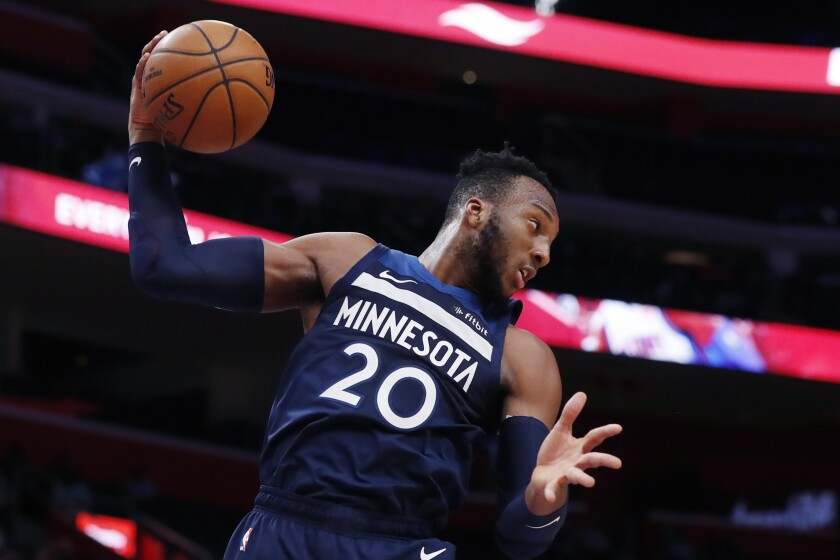 Minnesota Timberwolves guard Josh Okogie pulls down a rebound during the first half of an NBA basketball game against the Detroit Pistons, Monday, Nov. 11, 2019, in Detroit. (AP Photo/Carlos Osorio)