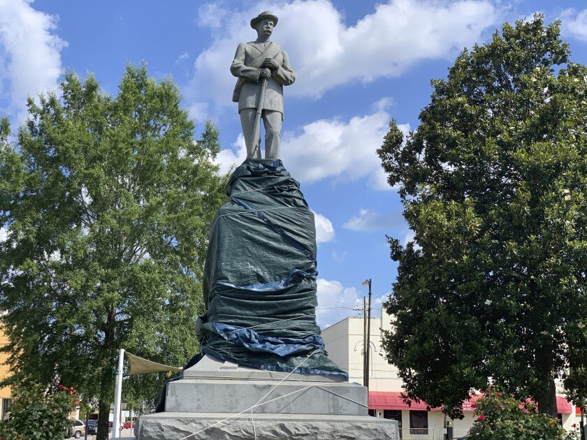 The base of a Confederate statue in Tuskegee, Ala., is covered with a tarp.