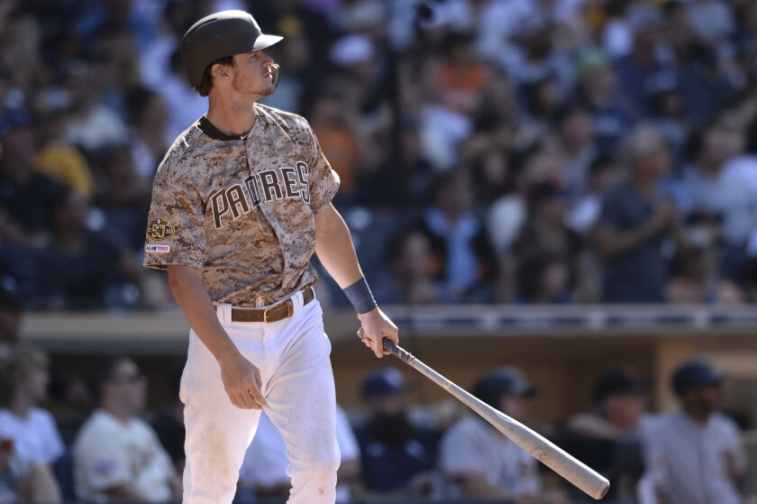 Wil Myers watches his two-run home run during the ninth inning of the Padres' game against the San Francisco Giants on Sunday.