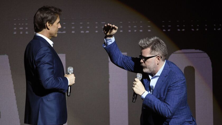 """Tom Cruise, left, and writer-director Christopher McQuarrie discuss """"Mission: Impossible — Fallout"""" at CinemaCon 2018."""
