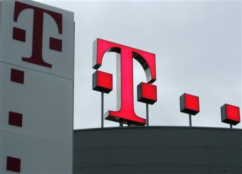 FILE- In this Feb. 28, 2008 file photo the logo of Deutsche Telekom at the headquarters in Bonn is shown. AT&T Inc. on Sunday, March 20, 2011 said it will buy T-Mobile USA from Deutsche Telekom AG in a cash-and-stock deal valued at $39 billion, becoming the largest cellphone company in the U.S. (AP Photo/Frank Augstein,