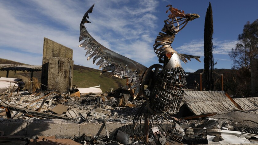 A sculpture of a phoenix created by artist Jessica Bierschenk, 17, of Pacific Palisades stands at her grandmother's burned home in Bell Canyon. Letty Bierschenk's home burned down in the Woolsey fire.