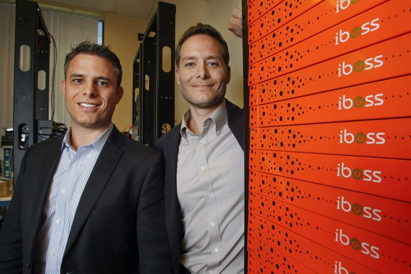 Chief Executive Paul Martini, left, and brother Peter Martini, president, stand next to a stack of iboss cyber security servers in this photo from April 2014.