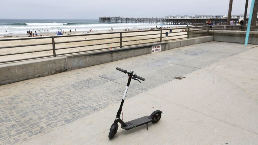 A Bird Scooter is parked on the boardwalk in Pacific Beach on June 13, 2018.