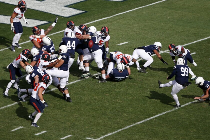 Illinois blocks a point after attempt by Penn State place kicker Joey Julius (99) during the first half of an NCAA college football game in State College, Pa., Saturday, Oct. 31, 2015. (AP Photo/Gene J. Puskar)