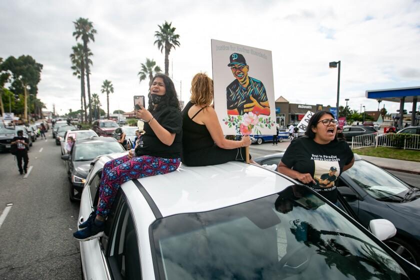 Jennifer Guardado rides in a caravan during the rally seeking justice for Guardado in Gardena