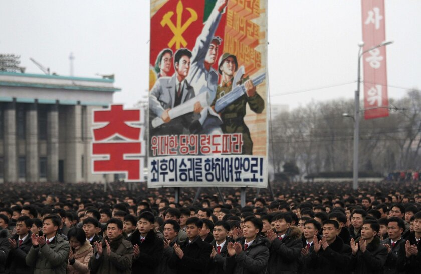 In this Feb. 8, 2016 photo, North Koreans gather at the Kim Il Sung Square to celebrate a satellite launch, in Pyongyang, North Korea. People in Pyongyang danced and watched fireworks the day after a rocket launch that has been strongly condemned by many countries around the world. (AP Photo/Jon Ch