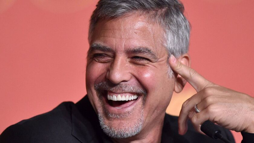 """""""You have to make fun of these situations,"""" George Clooney says of the fact that Donald Trump was elected president."""