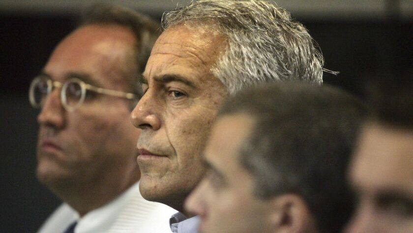 FILE- In this July 30, 2008 file photo, Jeffrey Epstein is shown in custody in West Palm Beach, Fla.