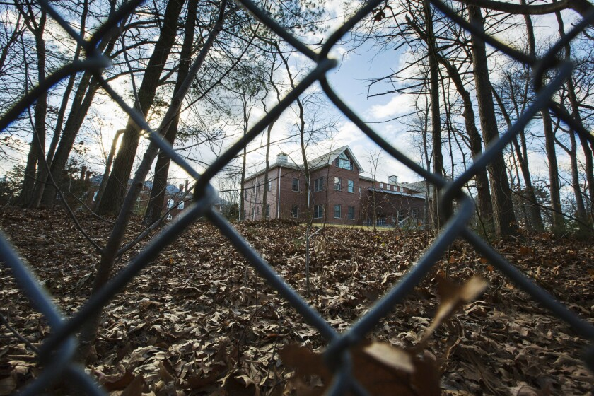A fence encloses an estate in the village of Upper Brookville on Long Island, Dec. 30, 2016. The Obama administration closed this compound for Russian diplomats in retaliation for spying and cyber-meddling in the U.S. presidential election.