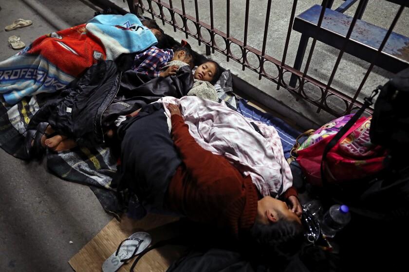 A migrant family camps near the border in Juarez, Mexico