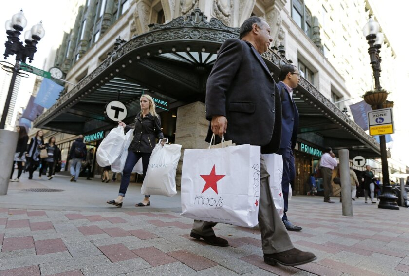 In this Wednesday, May 18, 2016, photo, shoppers carry their bags through the Downtown Crossing of Boston. On Friday, May 27, 2016, the University of Michigan issues its monthly index of consumer sentiment for May. (AP Photo/Charles Krupa)