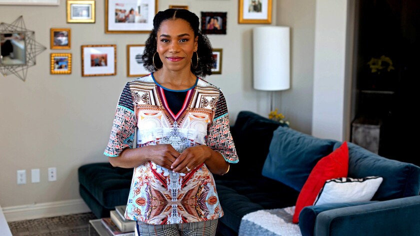 """Two years ago, actress Kelly McCreary met her fiance director Pete Chatmon on the set of """"Grey's Anatomy."""" In their living room, an expansive collage covers an entire wall with pictures and mementos, a visual guide to the life they have been building together recently."""