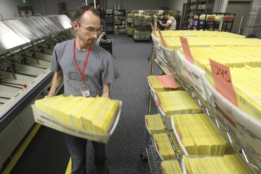 The Registrar of Voters headquarters was ramping up again on Wednesday morning to sort and count provisional and mail-in ballots that hold the key to at least two races in the county. Seasonal worker Andrew Kasten loaded sorted ballots into a cart.
