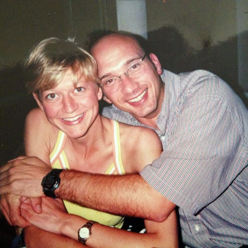Udo Heinz, right, hugs wife Antje Heinz in a photo taken a few years ago. Udo Heinz, 43, was killed Sunday when he was struck by a North County Transit bus on Camp Pendleton. Two other cyclists were injured in the crash.