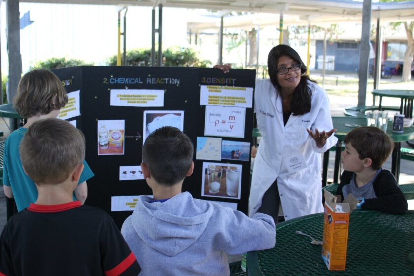 Bhawanjit Brar explains the stages of a chemical reaction, before letting the students see for themselves, by mixing vinegar with baking soda.