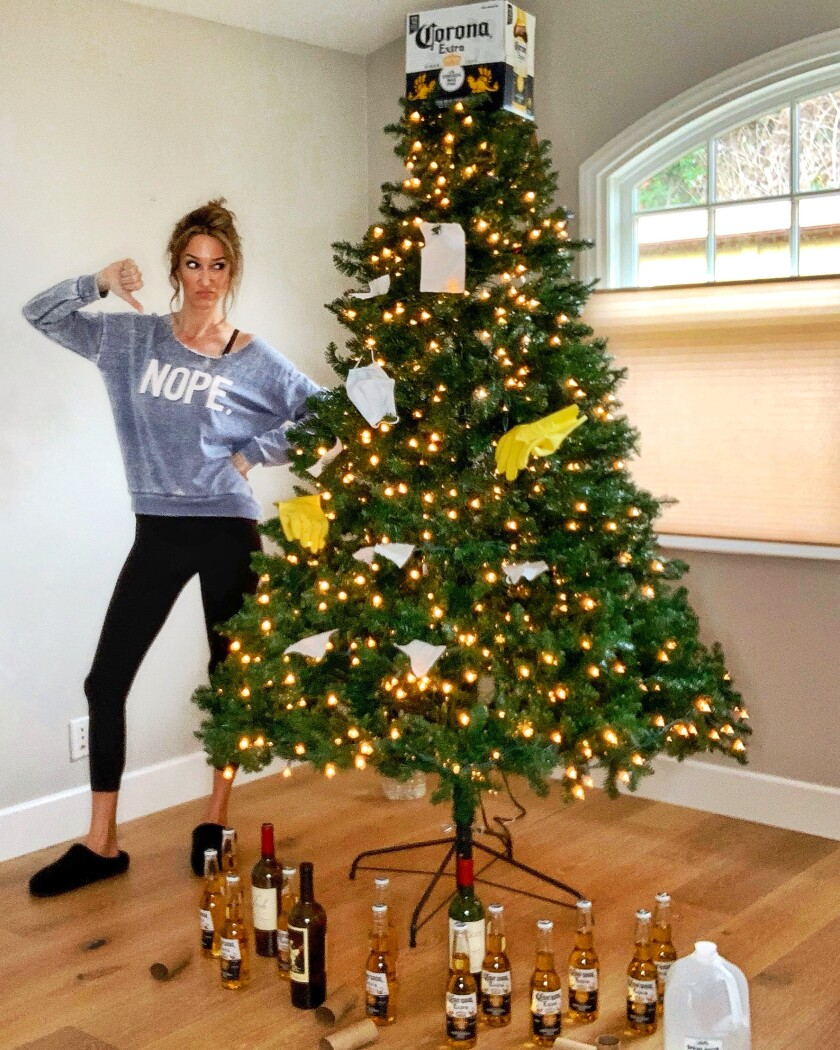 Nadia Colucci of Encinitas with her COVID-19-themed Christmas tree.