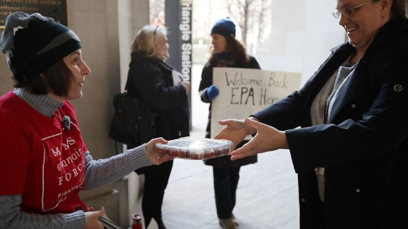 Furloughed Federal Employees Return To Work As Partial Government Shutdown Ends