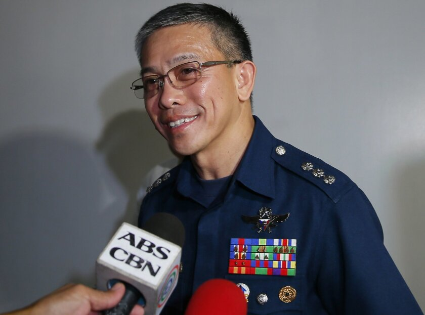 Col. Restituto Padilla, Spokesman of the Armed Forces of the Philippines, talks briefly to the media on the latest video of kidnapped Canadians, A Norwegian and a Filipino woman, as he arrives for a meeting with Foreign Affairs officials Wednesday, Nov. 4, 2015, 2015 at suburban Pasay city south of