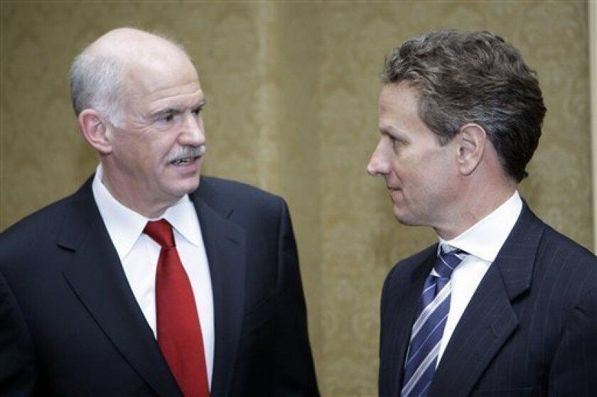 Treasury Secretary Timothy Geithner talks with Greek Prime Minister George Papandreou before their meeting, Tuesday, March 9, 2010, in Washington. (AP Photo/Haraz N. Ghanbari)
