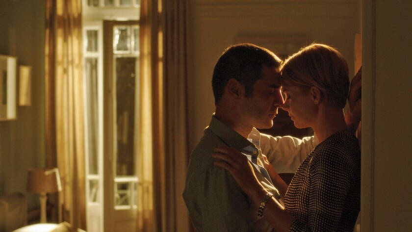"""Christopher Papakaliatis and Andrea Osvart in the film """"Worlds Apart."""""""