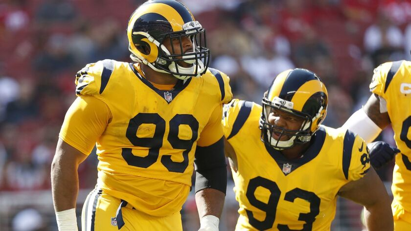 Los Angeles Rams defensive tackle Aaron Donald (99) celebrates with defensive tackle Ndamukong Suh (