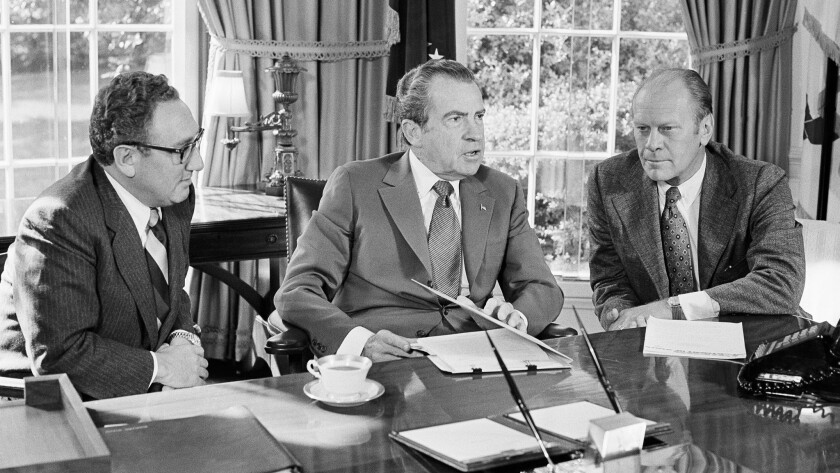 President Richard Nixon, center, meets with Henry Kissinger, left, and Vice President Gerald Ford in 1973. He resigned from office about 10 months later.
